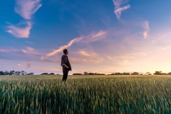 standing in field